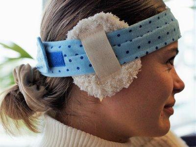 Twee oorkompressen met hoofdband